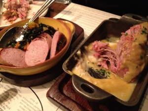 Milk braised pork shoulder (right) and house-made veal sausage (left).